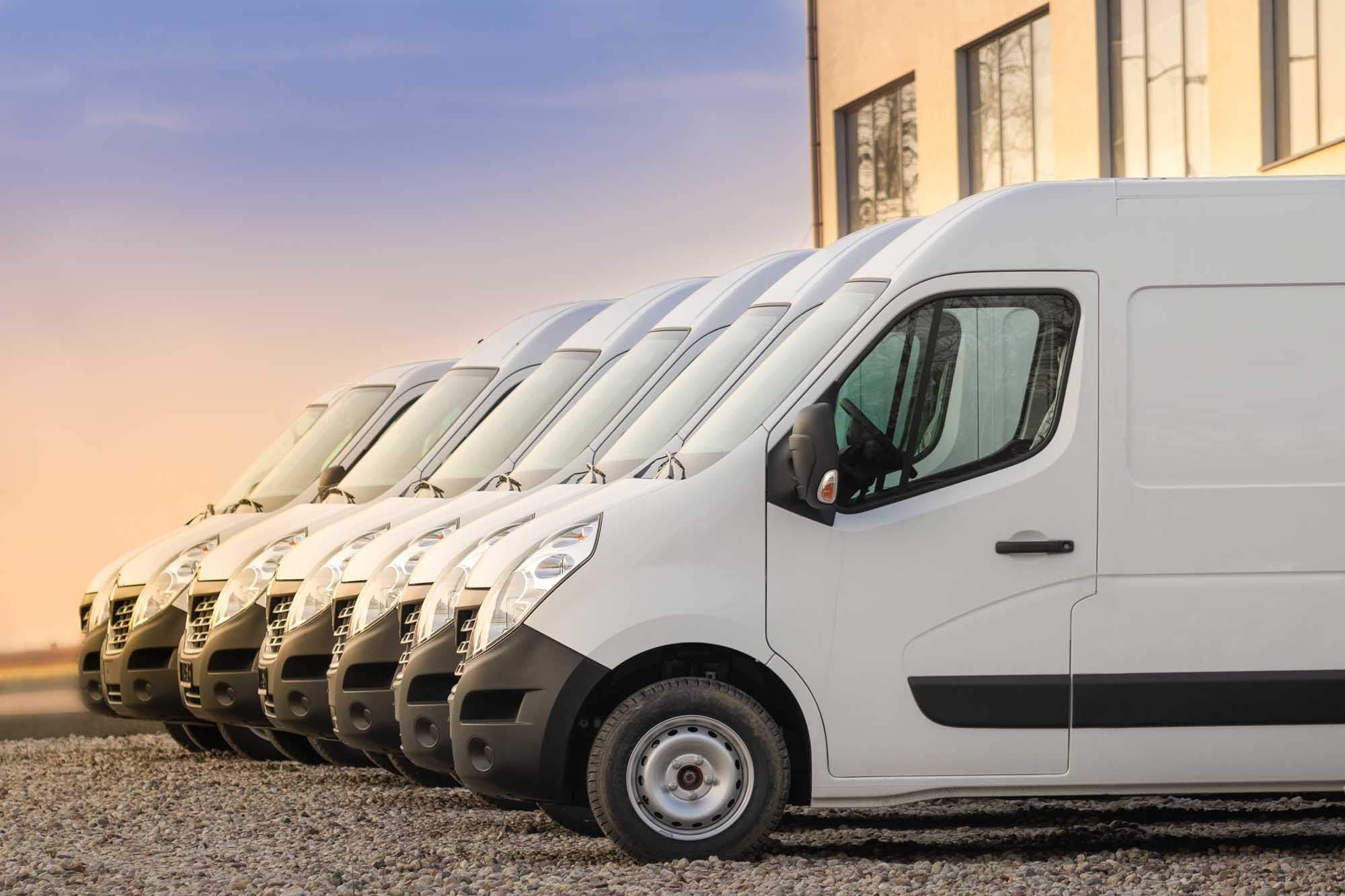 commercial delivery vans parked in row. Transporting service company.